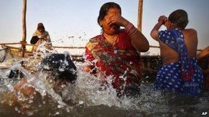 Pilgrims bathe at Sangam on 14 Feb 2013