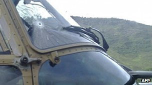 Bullet hole in army helicopter window in Papua (22 Feb 2013)