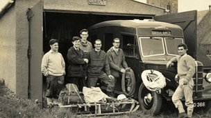 Team members with an ambulance in the 1950s