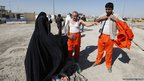 Freed detainees change out of their prison uniforms 