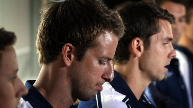 James Magnussen (2nd L) with teammates Cameron McEvoy (L) and Eamon Sullivan (R) from Australia's 4x100m freestyle relay team give a news conference in Sydney