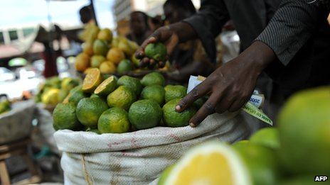 (File photo 2011) A stall holder sells fruit in Nakasero Market, Kampala