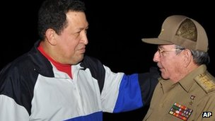 President Raul Castro (right) receives Venezuela's President Hugo Chavez in December 2012