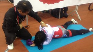 Japanese rider getting treatment at the Minsk Arena