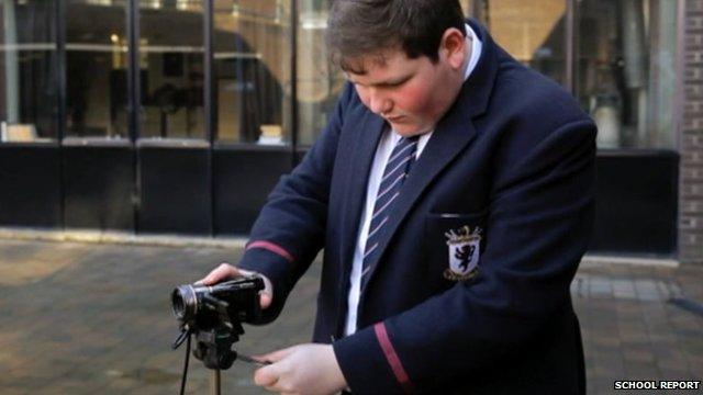 Student using a tripod