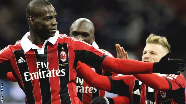 Mario Balotelli (left) celebrates scoring with AC Milan team-mates