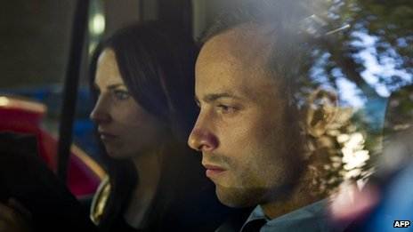 Olympic athlete Oscar Pistorius, right, and his sister Aimee are driven to a relative's home in Pretoria, South Africa, 22 February 2013