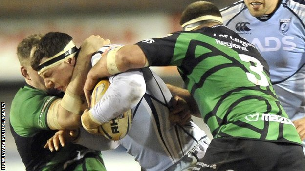 Robin Copeland of Cardiff Blues, centre, is tackled by Connacht's Michael Swift and Andrew White