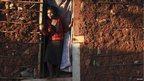 A woman standing in a doorway in Kibera, Kenya - Friday 15 February 2013