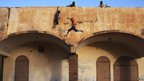 Children playing on Gao's stadium roof entrance, Mali - Wednesday 20 February 2013