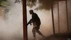 A Malian soldier amidst leaves and dust in Gao, Mali - Thursday 21 February 2013