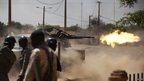 Malian soldiers firing a gun in Gao, Mali - Thursday 21 February 2013