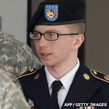 Pte Bradley Manning is escorted by military police as he departs the courtroom at Fort Meade, Maryland