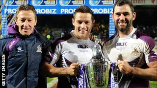 Craig Bellamy, Cooper Cronk and Cameron Smith celebrate the win