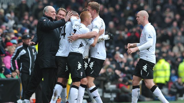 Martin Jol celebrates Fulham's goal against Stoke
