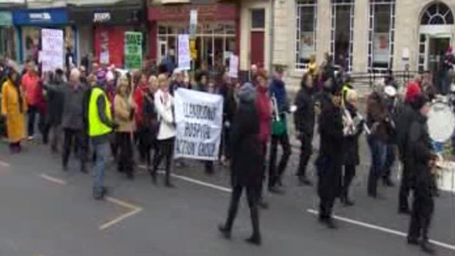 Opponents march over health shake-up