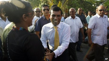 Former Maldives President Mohamed Nasheed, centre, shakes hands with a supporter after stepping out of the Indian High Commission in Male, Maldives, on Saturday