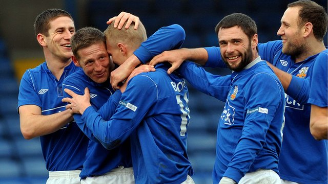 Glenavon players celebrate their 7-0 victory over Ballymena United