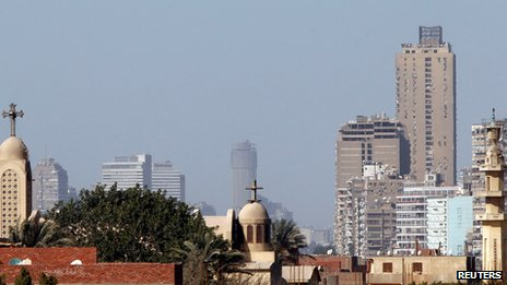 A mosque&#039;s minaret beside a Coptic church in Cairo (23 February 2013)