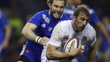 England captain Chris Robshaw (right) runs with the ball