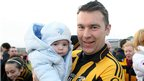 Oisin McConville pictured with his son Ryan after Crossmaglen's 3-9 to 0-11 over Pearse Og in the 2012 Armagh Club final