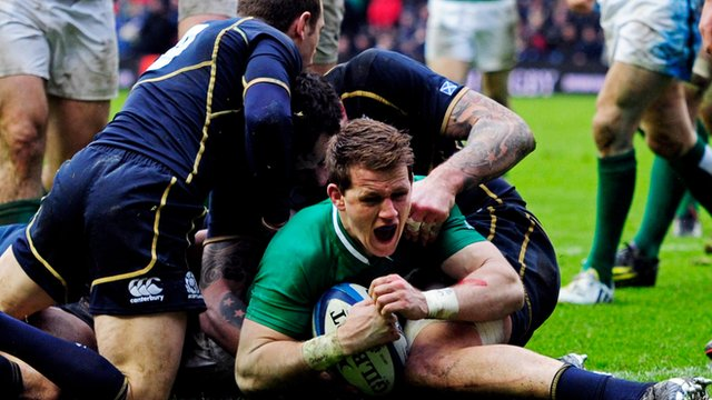 Craig Gilroy scores a try for Ireland against Scotland