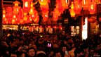 Crowds admire a lantern display in the Yuyuan Gardens in Shanghai