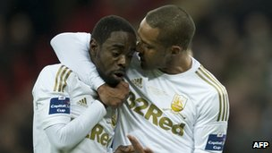 "Swansea City""s English midfielder Nathan Dyer (L) and Swansea City""s English midfielder Wayne Routledge (R) talk after Dyer loses out on taking the penalty during the League Cup final football"
