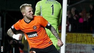 Johnny Russell celebrates his 86th minute penalty