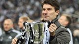 Swansea City manager Michael Laudrup lifts the Capital One Cup