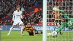 Michu finds the bottom corner to put Swansea City 2-0 ahead against Bradford City in the League Cup final at Wembley