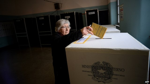 Woman casts her vote at polling station