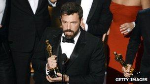 Ben Affleck, holding an Oscar