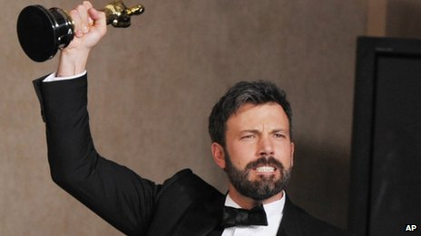 Ben Affleck poses with his award for best picture for Argo