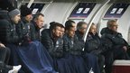 David Beckham wrapped up warm on the substitute's bench at a sub-zero Parc des Princes