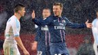 David Beckham came up against compatriot Joey Barton in a snowy Parc des Princes