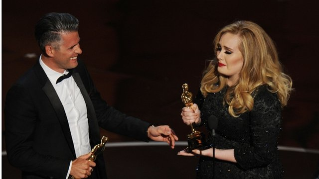 Paul Epworth and Adele Adkins accept their Oscars onstage