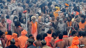 Hindu naked holy men take part in a procession to the Sangam at the Kumbh Mela in Allahabad 