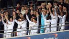 Swansea City players celebrate after their historic Capital One Cup five-nil victory over Bradford City at Wembley
