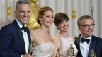 Best Actor Daniel Day-Lewis stands with Best Actress Jennifer Lawrence, Best Supporting Actress Anne Hathaway, and Best Supporting Actor Christoph Waltz