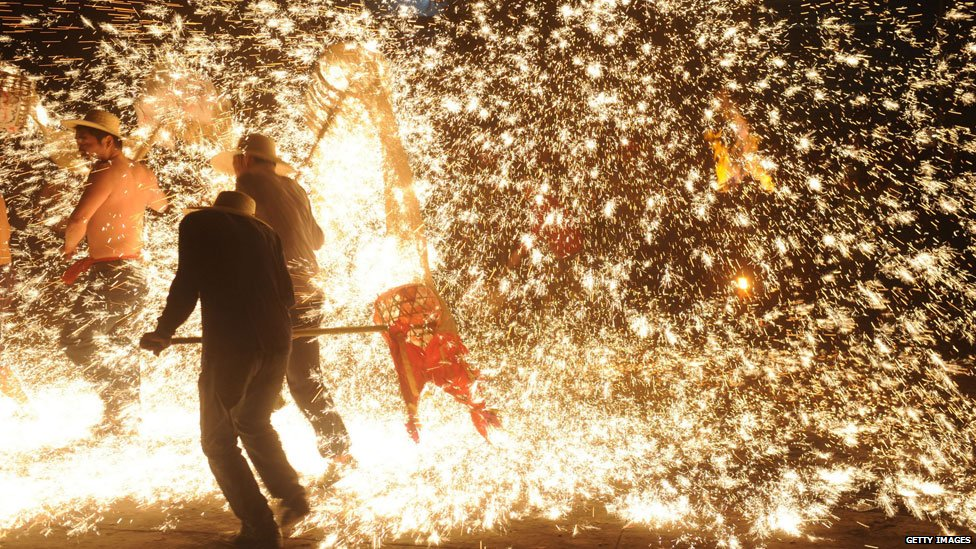 Traditional dragon dance in molten iron