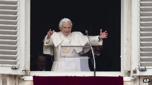 Pope Benedict XVI delivers his blessing during his last Angelus noon prayer, from the window of his studio overlooking St Peter&#039;s Square, at the Vatican (24 Feb 2013)