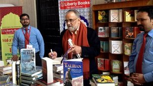 Ahmed Rashid signing books