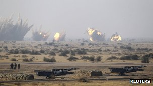 "Army soldiers watch as target is being destroyed during the Indian Air Force (IAF) fire power demonstration exercise ""Iron Fist 2013"" in Pokhran, Rajasthan February 22, 2013."