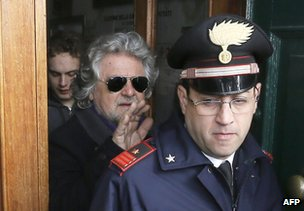 Beppe Grillo leaves a polling station after casting his ballot in Saint Ilario near Genoa, 25 February