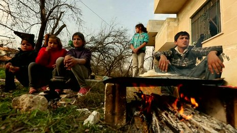 Syrian children outside a home in Idlib province