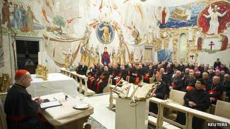 Cardinal Gianfranco Ravasi (L) addresses cardinals during the closing day of the Spiritual Exercises at the Vatican, 23 February 2013
