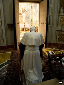 The Pope kneels in prayer at the end of a weeklong spiritual retreat, at the Vatican, Saturday, 23 February