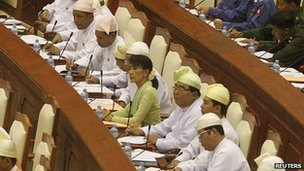 Aung Suu Kyi seated among fellow National League for Democracy members of parliament in Burma&#039;s lower house  on 9 July 2012
