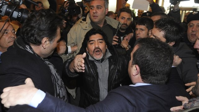 Maradona surrounded by journalists